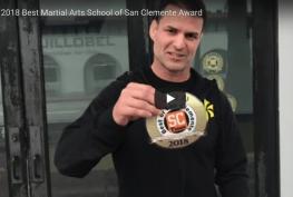 guillobel showing sticker of best martial arts school near me